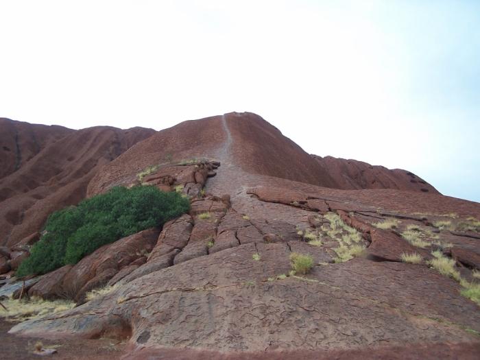 A rainy day at Uluru water runs down ayers rock nt
